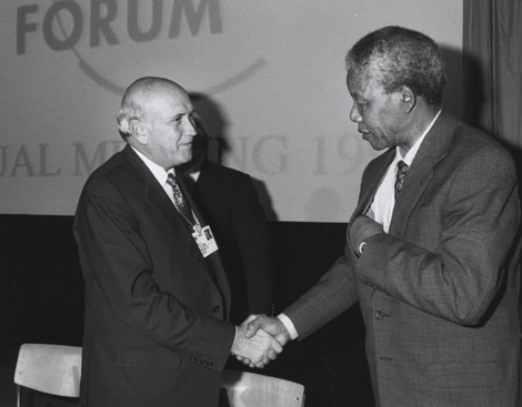 Frederik de Klerk and Nelson Mandela shake hands at the Annual Meeting of the World Economic Forum held in Davos in January 1992.