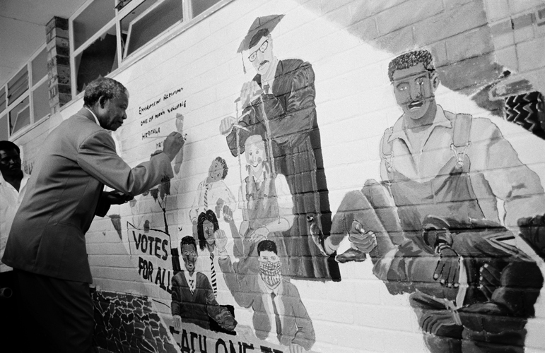Nelson Mandela signs mural at the Alexander Sinton Secondary School, 1992