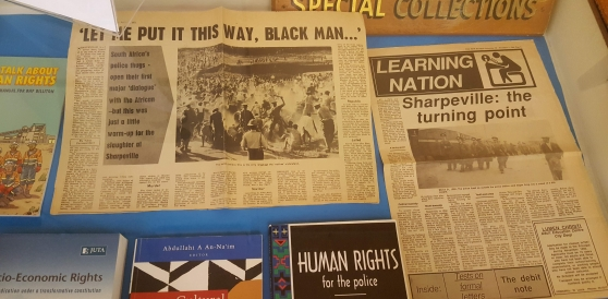 Newspaper articles and books about Sharpeville and human rights on display in Special Collections.