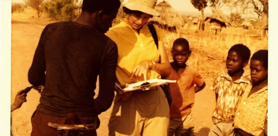 Pamela Reynolds with Costain Mangisi and Tonga children