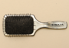 This hairbrush can be found among the many papers in this collection. Jack Simon loved to brush his wife's long hair.